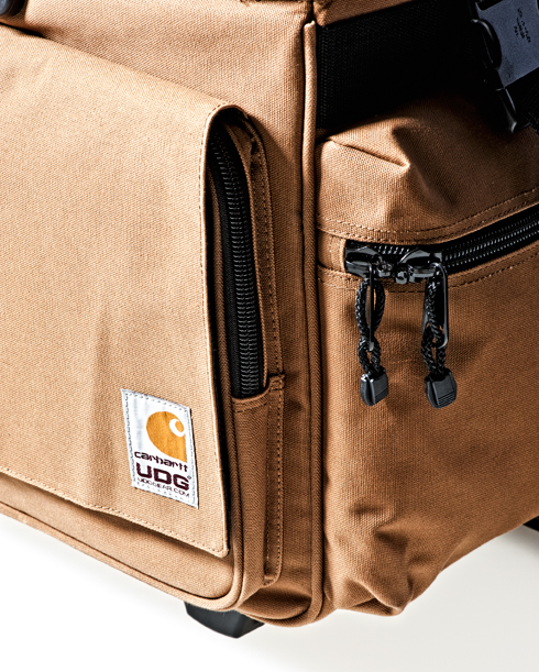 """41e15069c6b The Carhartt X UDG DJ Bag comes in one of the toughest fabrics available:  Cotton """"Duck"""" Canvas. It has been the characteristic material of Carhartt  clothes ..."""